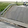 Chronicle File Photo<br /> <br /> A bridge on Keslinger Road west of South First Street in Afton Township collapsed on August 19, 2008 as seen here.