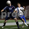 Rob Winner – rwinner@shawmedia.com<br /> <br /> Lisle's Mitch Boyce (13) and Hinckley-Big Rock's Bernie Conley chase after a ball during the second half of a Class 1A Naperville Central Super Sectional on Tuesday, October 25, 2011.