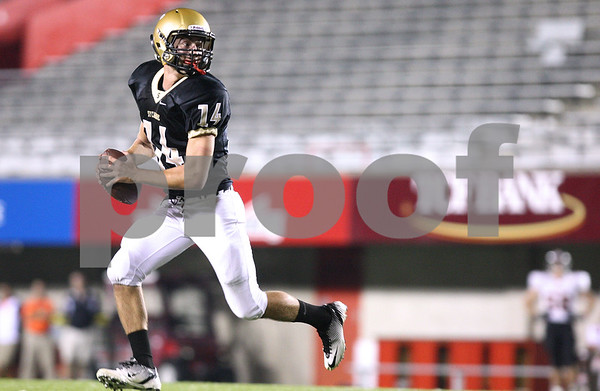 Kyle Bursaw – kbursaw@shawmedia.com<br /> <br /> Sycamore's David Compher (14) looks to pass while attempting a surprise two-point conversion in the first quarter of the annual DeKalb and Sycamore football game at Huskie Stadium in DeKalb, Ill. on Friday, September 9, 2011. Compher's pass fell incomplete.