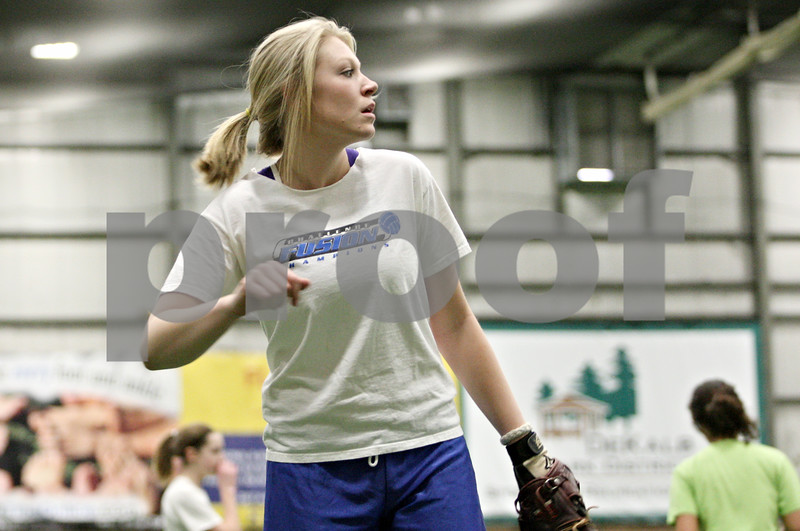Rob Winner – rwinner@daily-chronicle.com<br /> <br /> DeKalb's Mackenzie Johnson during softball practice at the DeKalb Park District Sports and Recreation Center on Tuesday, March 8, 2011.
