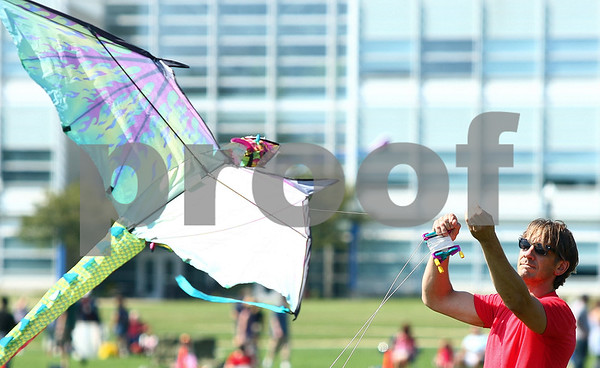 Kyle Bursaw – kbursaw@shawmedia.com<br /> <br /> Fred Heuschel of DeKalb tries to get his dragon kite airborne at Kite Fest on the Northern Illinois University campus on Sunday, Sept. 11, 2011.