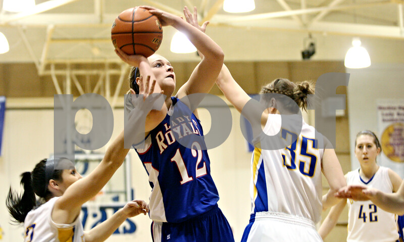 Rob Winner – rwinner@daily-chronicle.com<br /> <br /> Hinckley-Big Rock's Katie Hollis puts up two during the first quarter of the IHSA Class 1A Sectional game in Hinckley, Ill., on Monday February 14, 2011.