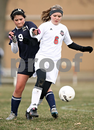 Rob Winner – rwinner@daily-chronicle.com<br /> <br /> Indian Creek's Sydney Bend (6) controls a ball in front of Hiawatha's Abi Garcia during the first half of their game in Waterman, Ill., on Thursday, March 24, 2011. Hiawatha defeated Indian Creek, 3-1.