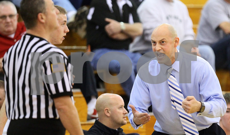 Kyle Bursaw – kbursaw@shawmedia.com<br /> <br /> Kaneland head coach Brian Johnson lets the referee know he wanted a traveling call against one of the Morris players in the second quarter of the Knights game against the Redskins in the Plano Christmas Classic in Plano, Ill. on Tuesday, Dec. 27, 2011. The Knights defeated the Redskins 50-44.