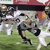 Wendy Kemp - For The Daily Chronicle<br /> Sycamore's Scott Baker (36) tackles DeKalb quarterback Brian Sisler during Friday's game at Huskie Stadium.<br /> DeKalb 9/9/11