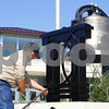 Kyle Bursaw – kbursaw@shawmedia.com<br /> <br /> Eric Almburg, owner of Almburg Custom Welding and Repair and a former DeKalb student, tightens up the frame around the 99-year-old DeKalb High School bell as he finishes installing it at its new home on West Dresser Road on Friday, Aug. 19, 2011.