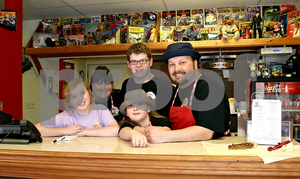 South Moon Barbeque, a family-run restaurant, opened in Hinckley earlier this month. Pictured from left are Bly Logan, owner Katie Logan, Kyle Logan (in back), Sean Logan and owner Harlan Logan.<br /> <br /> By Nicole Weskerna - nweskerna@daily-chronicle.com