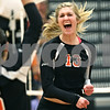 Rob Winner – rwinner@shawmedia.com<br /> <br /> DeKalb's Courtney Bemis celebrates a kill during the first game in DeKalb on Wednesday, Oct. 5, 2011. DeKalb defeated Sycamore, 28-26 and 25-19.