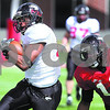 Kyle Bursaw – kbursaw@daily-chronicle.com<br /> <br /> Wide receiver Willie Clark gets away from defensive back Demetrius Stone during practice at Huskie Stadium on Saturday, April 2, 2011.