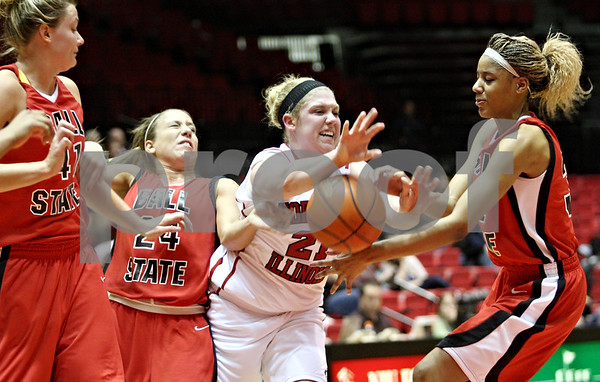 Rob Winner – rwinner@daily-chronicle.com<br /> <br /> Northern Illinois guard Courtney Shelton (21) tries to control a rebound during the first half in DeKalb, Ill. on Wednesday, Jan. 19, 2011.