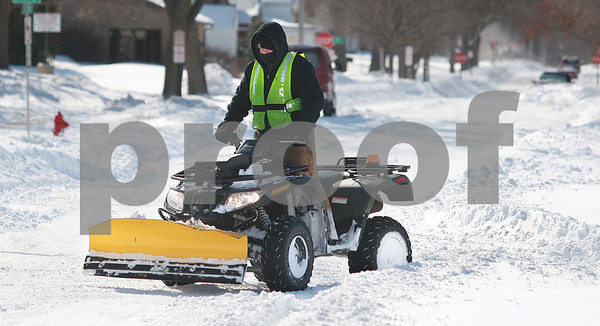 Kyle Bursaw – kbursaw@daily-chronicle.com<br /> <br /> Spencer Hillquist of Tovar Snow Professionals plows sidewalks and other areas on Second street on Wednesday, Feb. 2, 2011.