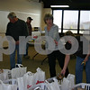 Mary Drake (far right) and other members of the Sycamore VFW and American Legion auxiliaries fill baskets with food to give to local veterans in need, who will pick up the baskets today. The food provides veterans and their families with the supplies for a Christmas meal.<br /> <br /> Caitlin Mullen - cmullen@shawmedia.com