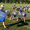 Kyle Bursaw – kbursaw@daily-chronicle.com<br /> <br /> Genoa-Kingston head coach Travis Frederick leads a squad of players in an offensive line drill during practice on Thursday, Aug. 11, 2011.