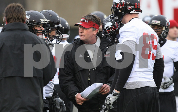 Kyle Bursaw – kbursaw@daily-chronicle.com<br /> <br /> Wide Receivers coach Bob Cole talks to his players during practice at Huskie Stadium on Tuesday, March 22, 2011.