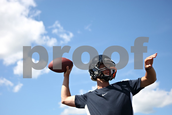 Rob Winner – rwinner@daily-chronicle.com<br /> <br /> Quarterback Brian Sisler loosens his arm during the first day of practice on Wednesday, Aug. 10, 2011, in DeKalb, Ill.