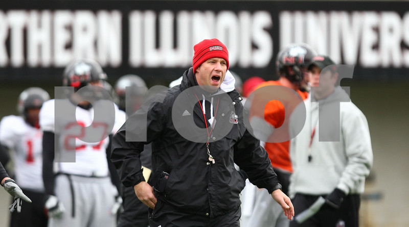 Kyle Bursaw – kbursaw@shawmedia.com<br /> <br /> Northern Illinois University head coach Dave Doeren calls out to players during practice on Tuesday, Dec. 20, 2011.