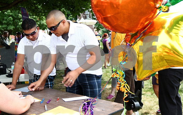 Kyle Bursaw – kbursaw@daily-chronicle.com<br /> <br /> Angel Cruz (left) and his partner Joel Filmore file paperwork for their civil union license in front of the DeKalb County Courthouse in Sycamore, Ill. on Friday, July 15, 2011.