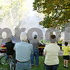 Rob Winner – rwinner@shawmedia.com<br /> <br /> Neighbors gather to watch as fire fighters work to extinguish a fire at a house located on the 200 block of South Genoa Street in Genoa on Wednesday afternoon.