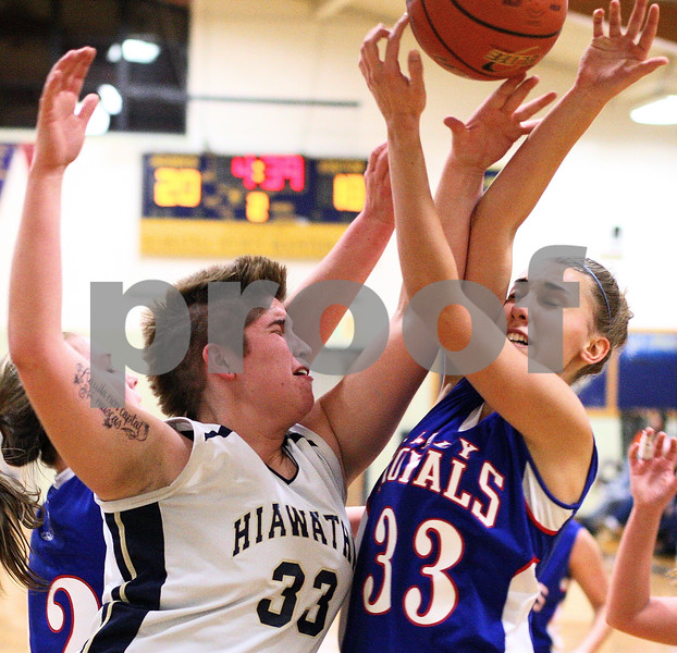 Kyle Bursaw – kbursaw@shawmedia.com<br /> <br /> Hiawatha's Randi Maynard and Hinckley-Big Rock's Karrigan Cowan collide going for a rebound during the second quarter of their game in Kirkland, Ill. on Monday, Dec. 12, 2011.