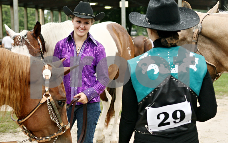 Rob Winner – rwinner@daily-chronicle.com<br /> <br /> Betsy Koehnke (left), 15, of Clare, and Katie Denius, 15, of Sycamore, prepare for a showmanship class during the 4-H Livestock Fair at the Sandwich Fairgrounds on Saturday morning.