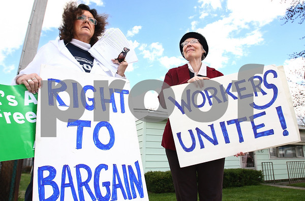 Kyle Bursaw – kbursaw@daily-chronicle.com<br /> <br /> Lolly Voss (left) and Jane Ann Moore hold up signs for those driving by the 1700 block of east Lincoln Highway in DeKalb, Ill. on Friday, May 6, 2011