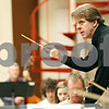 "Rob Winner – rwinner@daily-chronicle.com<br /> <br /> Conductor Linc Smelser uses his baton to communicate to performers of the Kishwaukee Symphony Orchestra during rehearsal at Northern Illinois University in DeKalb on Monday night. The orchestra is performing its last concert of the 2010-11 season, featuring the ""Titan"" and ""Jupiter"" symphonies on April 30."