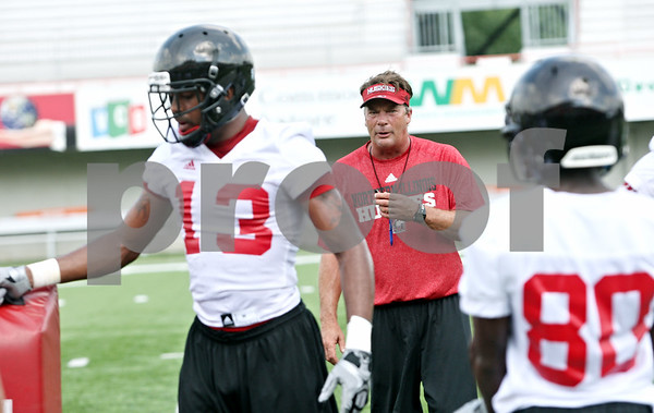 Rob Winner – rwinner@daily-chronicle.com<br /> <br /> Receivers coach Bob Cole works with his receivers during practice on Friday, Aug. 5, 2011, in DeKalb, Ill.