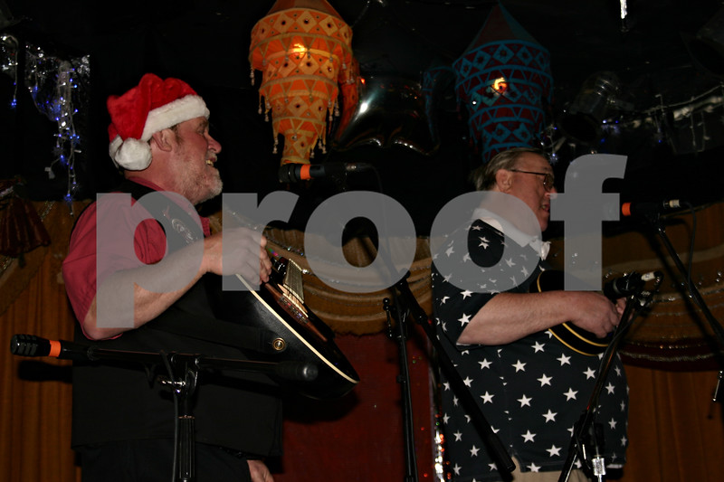 Jeff Engelhardt – jengelhardt@shawmedia.com<br /> Jake Thorn, left, and John Thorn of Basically Bluegrass kick off the 42nd annual Country Music Show Toy Drive at House Cafe Sunday. The show featured multiple bluegrass bands and helped collect toys for local children in need.