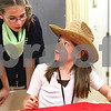 Kyle Bursaw – kbursaw@daily-chronicle.com<br /> <br /> Shiloh Smith, 10, (left) looks at a bandana that Kate Heegaard, 10, (right) is decorating during Vacation Bible School at Cornerstone Christian Academy on Wednesday, June 15, 2011.