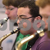 Kyle Bursaw – kbursaw@daily-chronicle.com<br /> <br /> Michael Armstrong (center) and the rest of the DeKalb high school jazz ensemble saxaphone section practices a tune at school on Friday, April 1, 2011.