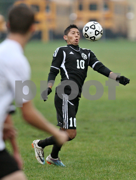 Rob Winner – rwinner@shawmedia.com<br /> <br /> Kaneland's Jordan Escobedo uses his chest to control a ball during the second half in Sycamore, Ill., on Tuesday, Sept. 27, 2011. Kaneland defeated Sycamore, 2-0.