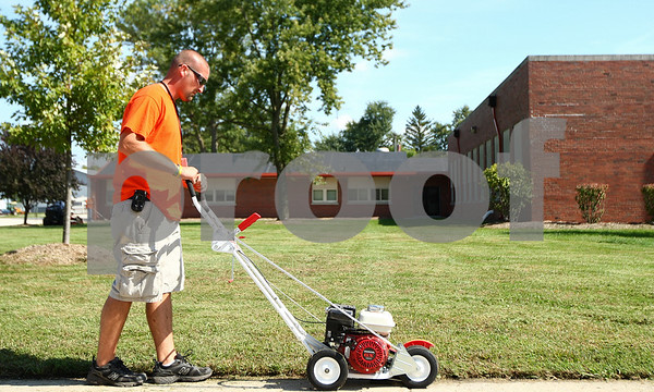 Kyle Bursaw – kbursaw@shawmedia.com<br /> <br /> Ben Brooks does edging in front of Malta Elementary on Tuesday, Sept. 20, 2011. Though the school is now closed, District 428 employees still do weekly maintenance at the building.
