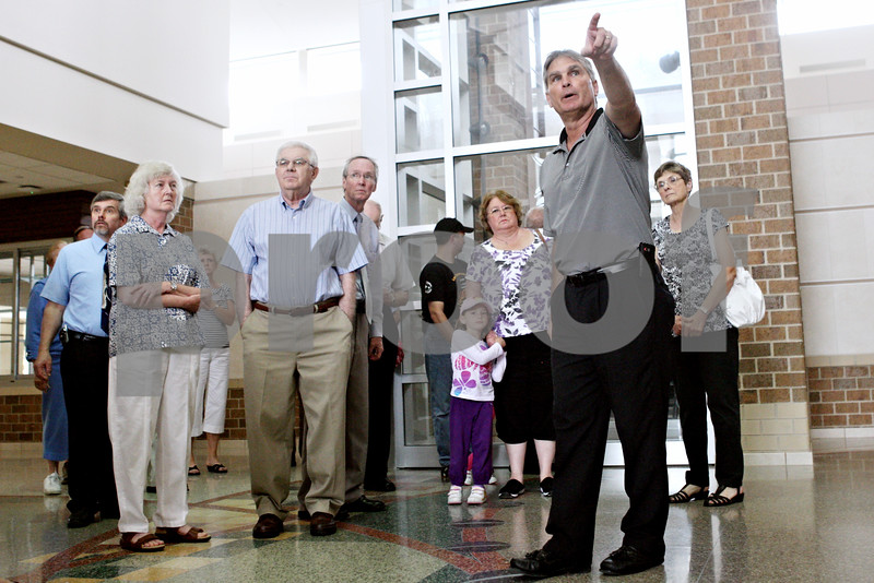 Rob Winner – rwinner@daily-chronicle.com<br /> <br /> Superintendent Jim Briscoe (front) gives a tour of the new DeKalb High School for the public as well as members of the DeKalb city council on Monday afternoon.