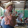 ANDREW MITCHELL — amitchell@daily-chronicle.com<br /> Steve Almburg of Almburg Auctioneering in Malta, officiates the annual DeKalb County 4-4 Blue Ribbon Auction at the Sandwich Fairgrounds.