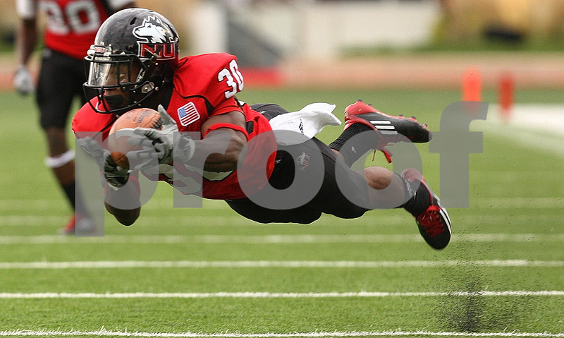 Kyle Bursaw – kbursaw@shawmedia.com<br /> <br /> Northern Illinois running back Akeem Daniels (30) makes a diving catch during the third quarter of the game against Cal Poly<br /> at Huskie Stadium in DeKalb, Ill. on Saturday, Sept. 24, 2011.