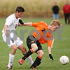 Rob Winner – rwinner@shawmedia.com<br /> <br /> Kaneland's Alex Gil (8) and DeKalb's Skyler Weishaar (20) go after a ball during the first half in Maple Park on Thursday, Sept. 29, 2011.