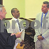 Bill Braksick - bbraksick@daily-chronicle.com<br /> <br /> Rich Rice (right) responds to Circuit Judge Thomas Doherty as Rice and John Calimee (center) are joined in a civil union during a ceremony Thursday afternoon at the DeKalb County Courthouse.