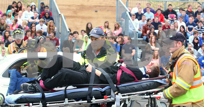 Kyle Bursaw – kbursaw@daily-chronicle.com<br /> <br /> During a simulation for Sycamore high school students to show the devastation of drinking and driving, emergency responders wheel away Sycamore student Trevor Cervenka on a stretcher on Wednesday, May 18, 2011.