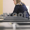 Kyle Bursaw – kbursaw@daily-chronicle.com<br /> <br /> Julie Nollkamper, a deputy clerk at the DeKalb county elections office, sets up ballot counting and collection devices for early voting in the Legislative Center at 200 N. Main street in Sycamore, Ill. on Friday, March 11, 2011.