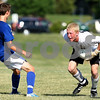 Kyle Bursaw – kbursaw@daily-chronicle.com<br /> <br /> DeKalb goalkeeper Cully Hicks scoops a ball up in front of a Burlington Central player looking to score in the first half at Huntley Middle School on Friday, July 22, 2011.