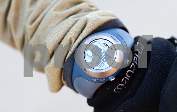 Kyle Bursaw – kbursaw@shawmedia.com<br /> <br /> Cohen Barnes, who runs at least three miles every day, uses a gps watch to help measure his various running statistics.