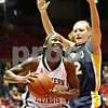 Rob Winner – rwinner@daily-chronicle.com<br /> <br /> Northern Illinois center Ebony Ellis (front) looks to shoot as Toledo forward Melissa Goodall defends during the first half on Saturday, Feb. 26, 2011 in DeKalb, Ill.