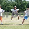 Rob Winner – rwinner@daily-chronicle.com<br /> <br /> Jarrell Wilson (center) teaches young players all the different position stances during the DeKalb Bengals Football Camp in DeKalb on Monday evening.
