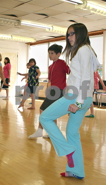 By ANDREW MITCHELL — amitchell@daily-chronicle.com<br /> Carolyn McCarthy, 10, of Genoa, learns how to dance a Charleston in the Northern Illinois University Stevens Building during Children's Community Theatre's Imagaination Camp.