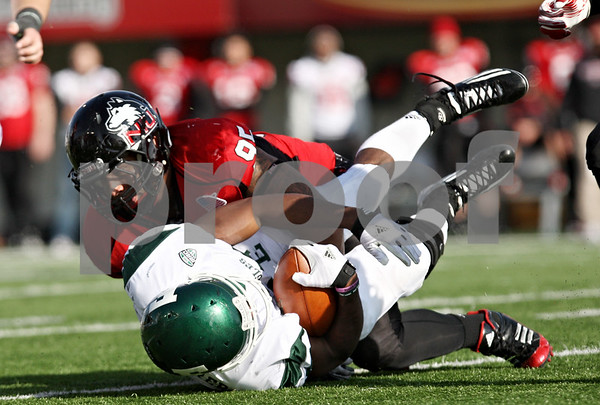 Rob Winner – rwinner@shawmedia.com<br /> <br /> Northern Illinois defensive end Sean Progar (95) tackles Eastern Michigan running back Dominique Sherrer (25) after a five yard rush during the third quarter in DeKalb, Ill., on Friday, Nov. 25, 2011. Northern Illinois defeated Eastern Michigan, 18-12.