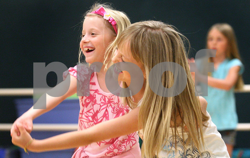 Kyle Bursaw – kbursaw@daily-chronicle.com<br /> <br /> McKenna Nonnenmann (left) and Summer Hollis dance with each other in the dance course at the summer day camp at the Kishwaukee Family YMCA  on Friday, June 10, 2011.