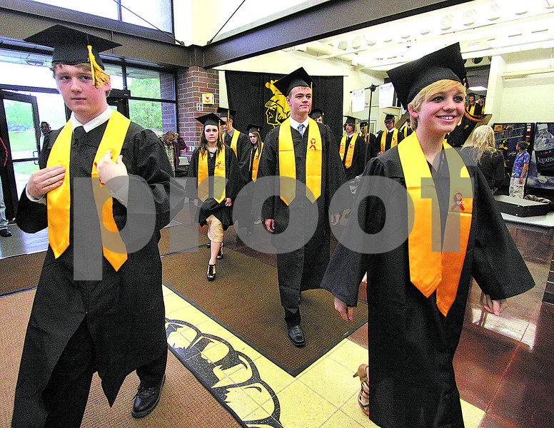 Wendy Kemp - For The Daily Chronicle<br /> Graduates begin the processional at the commencement ceremony at Sycamore High School on Sunday.<br /> Sycamore 5/29/11