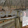 Rob Winner – rwinner@shawmedia.com<br /> <br /> A sign warning visitors to leash their dogs is posted near a bridge which crosses the Kishwaukee River at Russell Woods in Genoa as seen on Saturday, Nov. 26, 2011.