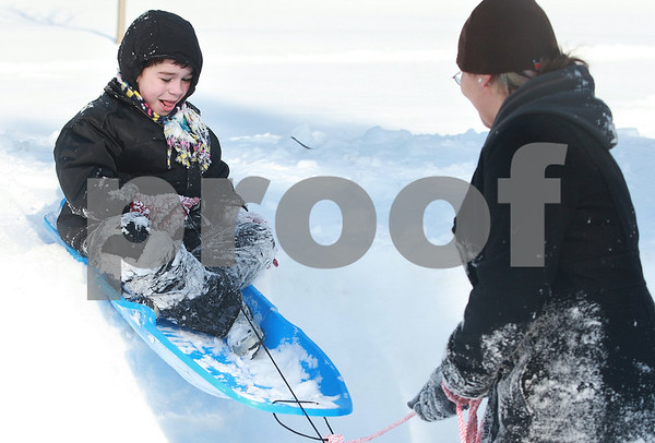 Kyle Bursaw – kbursaw@daily-chronicle.com<br /> <br /> Abigail Johnson, 15, pulls her little brother Hunter Tarkenton, 8, in his sled down a small slope in DeKalb, Ill. on Wednesday, Feb. 2, 2011.