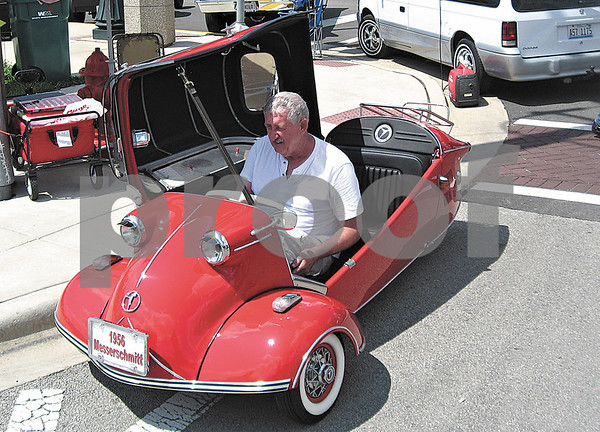 Steve Lenoch sits at the wheel of a 1956 Messerschmitt he brought to the Fizz Ehrler Memorial Car Show in Sycamore from Coralville, Iowa.
